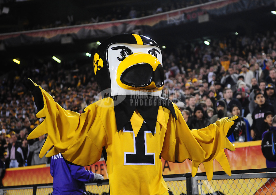 Dec. 28, 2010; Tempe, AZ, USA; Iowa Hawkeyes mascot Herky the Hawk against the Missouri Tigers in the 2010 Insight Bowl at Sun Devil Stadium. Iowa defeated Missouri 27-24. Mandatory Credit: Mark J. Rebilas-