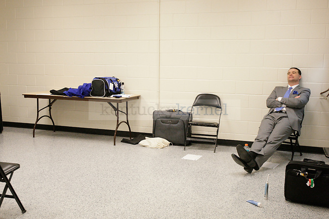 UK Head Coach Matthew Mitchell sits by himself outside of the locker room after the University of Kentucky women's basketball game vs. Texas A&M University during the SEC Tournament Championship Game at The Arena at Gwinnett Center in Duluth, Ga., on Sunday, March 10, 2013. UK lost the Championship game 75-67. Photo by Tessa Lighty | Staff