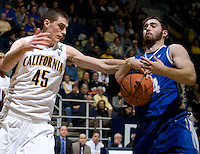 David Kravish of California tries to steal the ball away from Ethan Wragge of Creighton during the game at Haas Pavilion in Berkeley, California on December 15th, 2012.   Creighton defeated California, 74-64.