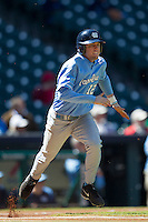 North Carolina Tar Heels shortstop Landon Lassiter #12 runs to first base against the California Golden Bears in the NCAA baseball game on March 2nd, 2013 at Minute Maid Park in Houston, Texas. North Carolina defeated Cal 11-5. (Andrew Woolley/Four Seam Images).