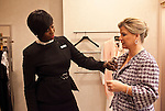 Neiman Marcus personal shopper Claudia Coleman organizes clothing options to the taste of Karin Berkendorff at the Shops at La Cantera location in San Antonio, Texas on January 31, 2012. Coleman has been working with Berkendorff for 16 years.