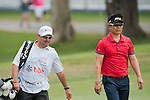 Yong-eun Yang of South Korea and his caddie walk during Hong Kong Open golf tournament at the Fanling golf course on 25 October 2015 in Hong Kong, China. Photo by Xaume Olleros / Power Sport Images
