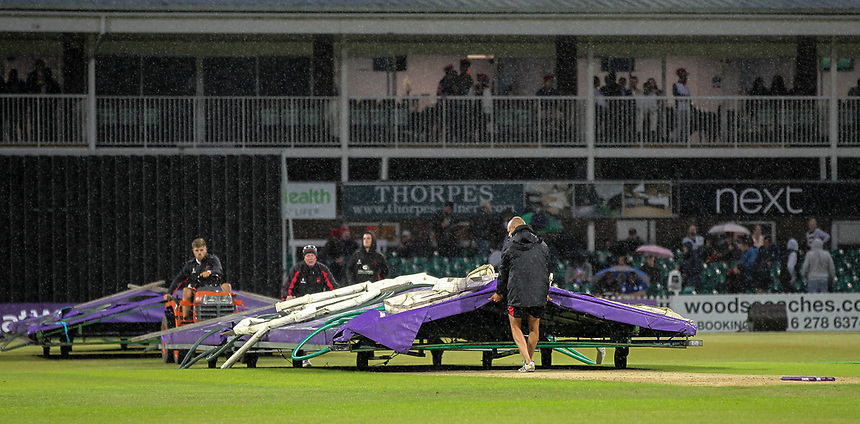 Leicestershire's groundstaff cover the pitch due to heavy rainfall.<br /> <br /> Photographer Andrew Kearns/CameraSport<br /> <br /> NatWest T20 Blast - Leicestershire Foxes vs Northamptonshire Steelbacks - Friday 21st July 2017 - Grace Road Leicester <br /> <br /> World Copyright &copy; 2017 CameraSport. All rights reserved. 43 Linden Ave. Countesthorpe. Leicester. England. LE8 5PG - Tel: +44 (0) 116 277 4147 - admin@camerasport.com - www.camerasport.com