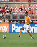 Houston Dynamo defender Patrick Ianni (4) passes the ball. The Houston Dynamo tied the Columbus Crew 1-1 in a regular season MLS match at Robertson Stadium in Houston, TX on August 25, 2007.