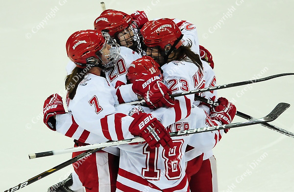 The Badgers celebrate a second period goal by Hilary Knight (23), as the Wisconsin women's hockey team tops Minnesota-Duluth 2-1 to advance to the Frozen Four on Saturday, 3/12/11, at the Kohl Center in Madison, Wisconsin
