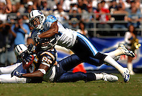 Sept. 17, 2006; San Diego, CA, USA; San Diego Chargers tight end (85) Antonio Gates is tackled by Tennessee Titans safety (24) Chris Hope at Qualcomm Stadium in San Diego, CA. Mandatory Credit: Mark J. Rebilas