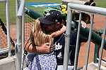 03 June 2016: Nova Southeastern head coach Greg Brown hugs his daughter Kooper Brown before the game. The Nova Southeastern University Sharks played the Millersville University Marauders in Game 13 of the 2016 NCAA Division II College World Series  at Coleman Field at the USA Baseball National Training Complex in Cary, North Carolina. Nova Southeastern won the first game of the best of three Championship Series 2-1.
