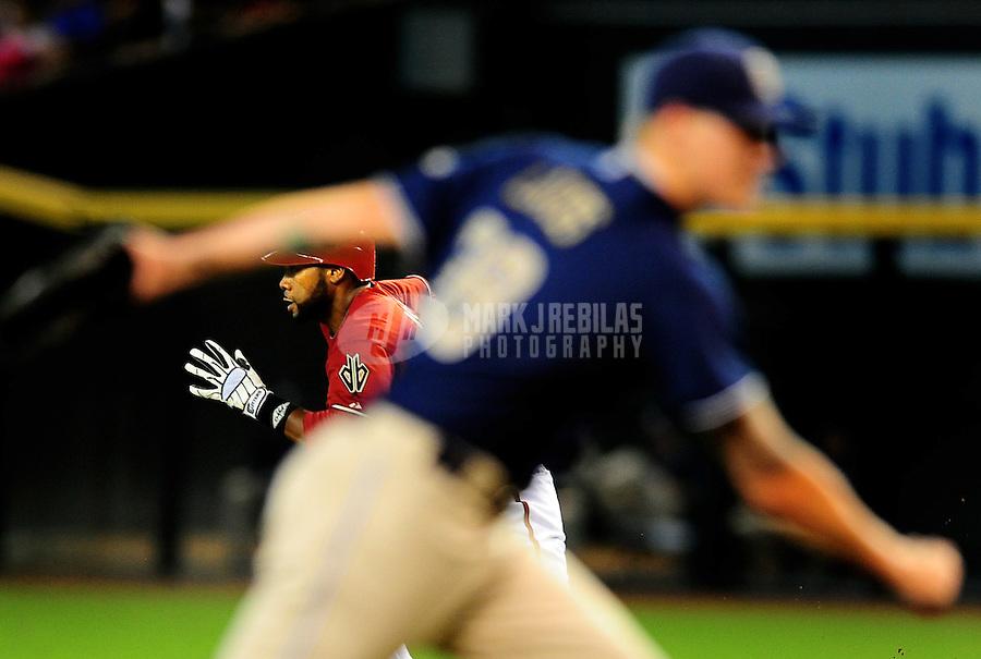 Sept. 1, 2010; Phoenix, AZ, USA; Arizona Diamondbacks baserunner Brandon Allen (red) runs to second against the San Diego Padres at Chase Field. The Diamondbacks defeated the Padres 5-2. Mandatory Credit: Mark J. Rebilas-
