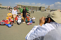 ULAN BATOR, MONGOLIA..08/21/2001.Souvenir photographers at Sukhbaatar Square, Government House in background..(Photo by Heimo Aga)