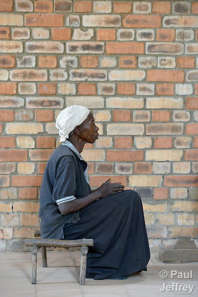 A woman prays during mass in the Catholic Church in Riimenze, South Sudan.