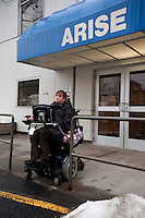 Kara leaves Arise to visit a client in a nursing home. Photo by James R. Evans©