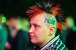 © Joel Goodman - 07973 332324 . 31/08/2015 . Manchester , UK . A woman with a PRIDE tattoo on her head at a candlelit vigil in memory of the victims of HIV and AIDS , in Sackville Gardens in Manchester's Gay Village , closes 2015 Manchester Pride . Photo credit : Joel Goodman