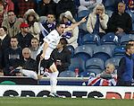 QOS's Nicky Clark celebrates his goal