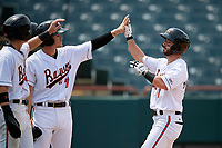 Bowie Baysox Ryan McKenna (1) high fives Preston Palmeiro (7) and Chris Clare (9) after hitting a three run home run in the bottom of the ninth inning during an Eastern League game against the Akron RubberDucks on May 30, 2019 at Prince George's Stadium in Bowie, Maryland.  Akron defeated Bowie 9-5.  (Mike Janes/Four Seam Images)