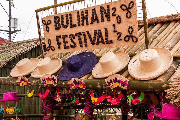 A sign and products of buri palm decorate one of several market booths set up in Sampaloc's municipal plaza for the Bulihan Festival 2012.  (Sampaloc, Quezon Province, the Philippines.)