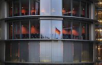 Paul-Lobe-Haus reflecting the German flag, architect Stephane Braunfels, 2001, a government building for the new parliamentary complex in the new government quarter of Berlin, on the banks of the river Spree on Federal Row, Berlin, Germany. It is connected to the Chancellery and together with the Marie-Elisabeth-Luders House on the opposite side of the Spree it forms a formal and functional whole. The building contains more than 900 offices for the parliamentary deputies. It is named after Paul Lobe, 1875-1967, the last democratic president of the Weimar Republic. Picture by Manuel Cohen