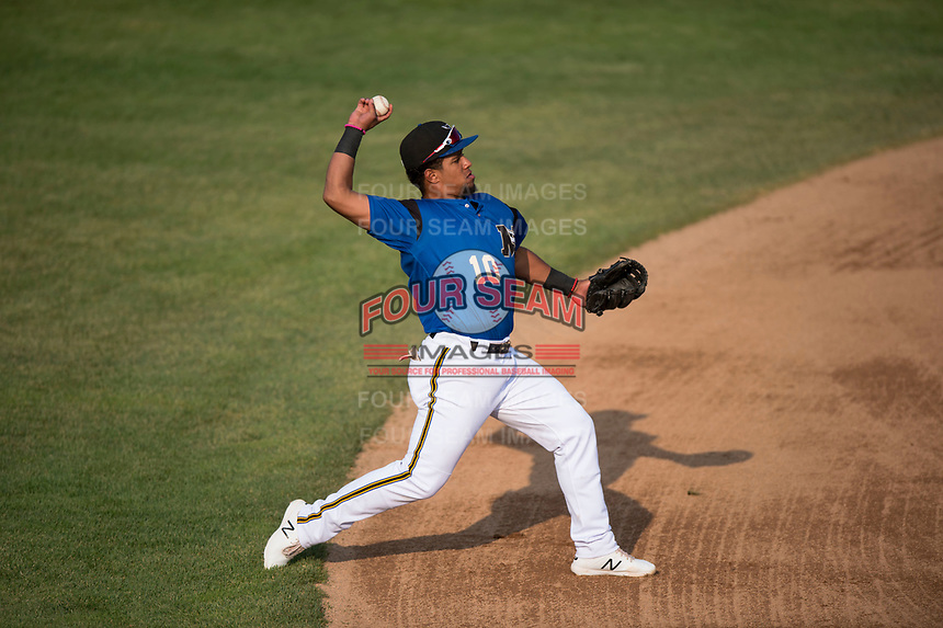 Missoula Osprey third baseman Eddie Hernandez (10) throws to first base during a Pioneer League game against the Grand Junction Rockies at Ogren Park Allegiance Field on August 21, 2018 in Missoula, Montana. The Missoula Osprey defeated the Grand Junction Rockies by a score of 2-1. (Zachary Lucy/Four Seam Images)