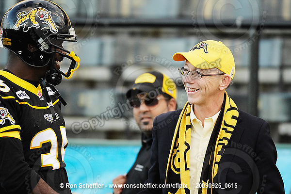 September 25, 2009; Hamilton, ON, CAN; Hamilton Tiger-Cats owner Bob Young greets linebacker Otis Floyd (35). CFL football: Montreal Alouettes vs. Hamilton Tiger-Cats at Ivor Wynne Stadium. The Alouettes defeated the Tiger-Cats 42-8. Mandatory Credit: Ron Scheffler. Copyright (c) 2009 Ron Scheffler.