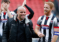 Grimsby Town manager, Marcus Bignot and Craig Disley share a joke during the Sky Bet League 2 match between Leyton Orient and Grimsby Town at the Matchroom Stadium, London, England on 11 March 2017. Photo by Carlton Myrie / PRiME Media Images.
