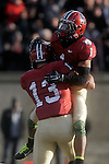 (Cambridge Ma 11/22/14) Harvard 1, Andrew Fischer, gets a celebrative lift from 13, Matt Brown, after a touch down in the second half, Yale would come back to tie the game later in the half before Fischer last touch down put the game away, as Harvard defeated Yale 31-24. Jim Michaud Photo