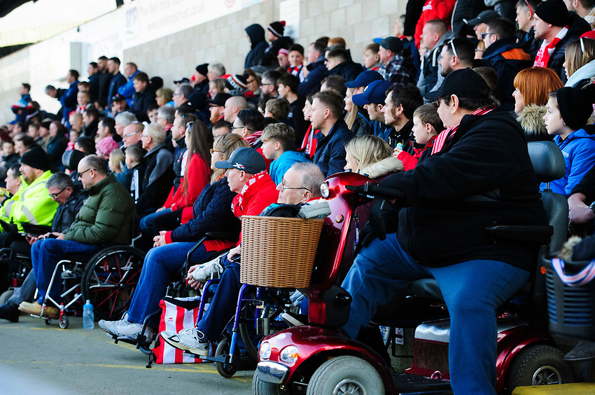 Lincoln City fans watch their team in action<br /> <br /> Photographer Chris Vaughan/CameraSport<br /> <br /> The EFL Sky Bet League Two - Lincoln City v Stevenage - Saturday 16th February 2019 - Sincil Bank - Lincoln<br /> <br /> World Copyright © 2019 CameraSport. All rights reserved. 43 Linden Ave. Countesthorpe. Leicester. England. LE8 5PG - Tel: +44 (0) 116 277 4147 - admin@camerasport.com - www.camerasport.com