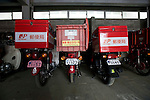 Japan Post Service Co., Ltd. motorbikes stand in the sheds of the offices in Ishinomaki city, Miyagi Prefecture, Japan on Tuesday 24 May 2011. Some 30 trucks and 50 motorbikes at the branch were destroyed by the March 11 quake and tsunamis..Photographer: Robert Gilhooly