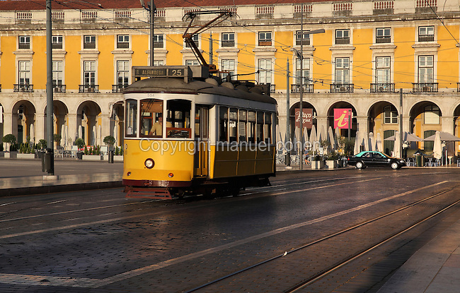 Tram and building with colonnade on the Placa do Commercio or Commerce Square, Lisbon, Portugal. The square was previously known as Terreiro do Paco or Palace Square as it was the site of the Pacos da Ribeira or Royal Ribeira Palace until it was destroyed in the 1755 earthquake. Picture by Manuel Cohen