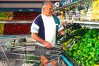 Healthy retired man shopping for vegetables