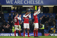 Shkodran Mustafi, Alex Iwobi and Granit Xhaka of Arsenal applaud the away fans after the match during Chelsea vs Arsenal, Caraboa Cup Football at Stamford Bridge on 10th January 2018