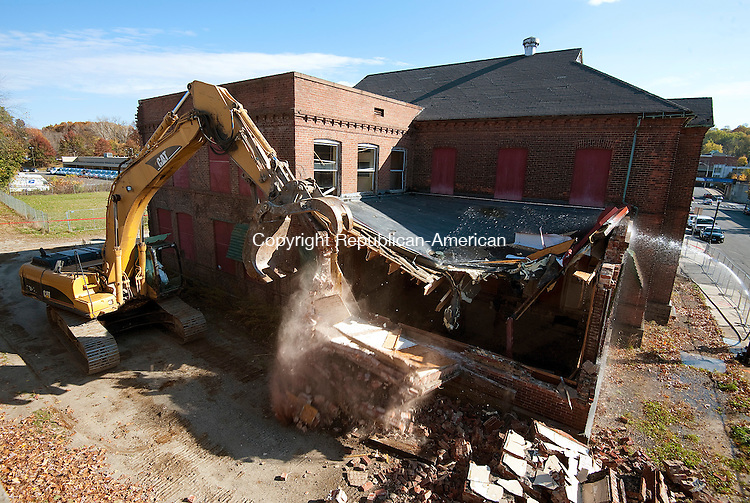 NAUGATUCK, CT-110314JS03-  Building 25 on Maple Street in Naugatuck, the last major remnant of the U.S. Rubber Company, was demolished on Monday.<br /> Jim Shannon Republican-American