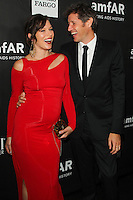 HOLLYWOOD, LOS ANGELES, CA, USA - OCTOBER 29: Milla Jovovich, Paul W.S. Anderson arrive at the 2014 amfAR LA Inspiration Gala at Milk Studios on October 29, 2014 in Hollywood, Los Angeles, California, United States. (Photo by Celebrity Monitor)
