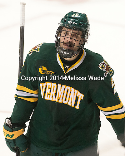 Brady Shaw (UVM - 22) - The visiting University of Vermont Catamounts defeated the Northeastern University Huskies 6-2 on Saturday, October 11, 2014, at Matthews Arena in Boston, Massachusetts.