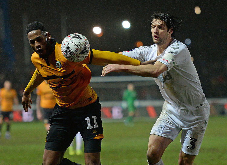 Newport County's Jamille Matt battles with Middlesbrough's George Friend<br /> <br /> Photographer Ian Cook/CameraSport<br /> <br /> Emirates FA Cup Fourth Round Replay - Newport County v Middlesbrough - Tuesday 5th February 2019 - Rodney Parade - Newport<br />  <br /> World Copyright &copy; 2019 CameraSport. All rights reserved. 43 Linden Ave. Countesthorpe. Leicester. England. LE8 5PG - Tel: +44 (0) 116 277 4147 - admin@camerasport.com - www.camerasport.com