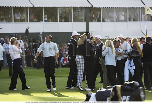 EUROPEAN TEAM celebrate Paul McGinley's winning singles match which secured the Ryder Cup victory on the 18th Green, The 34th Ryder Cup 2002, The Belfry, Sutton Coldfield, 020929. Photo: Glyn Kirk/Action Plus....golf golfer.celebrate celebration celebrations joy....