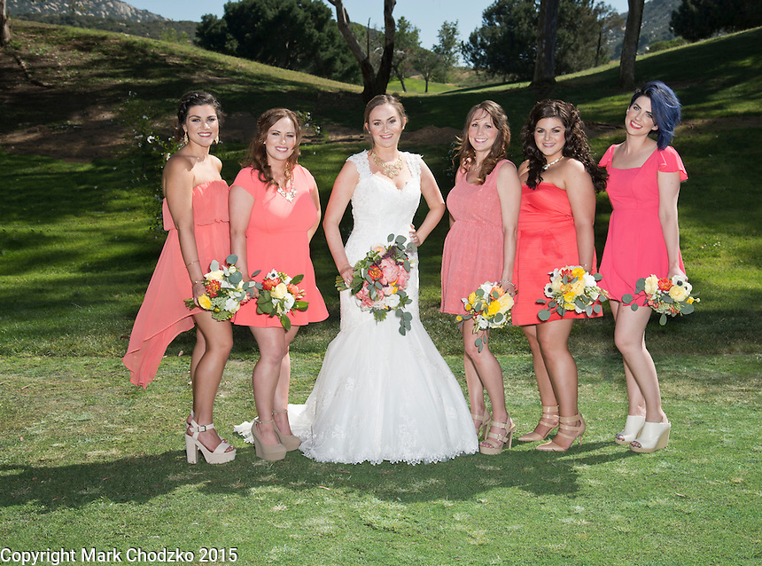 Bridesmaids pose with the bide, Lauren Kelly Carlton