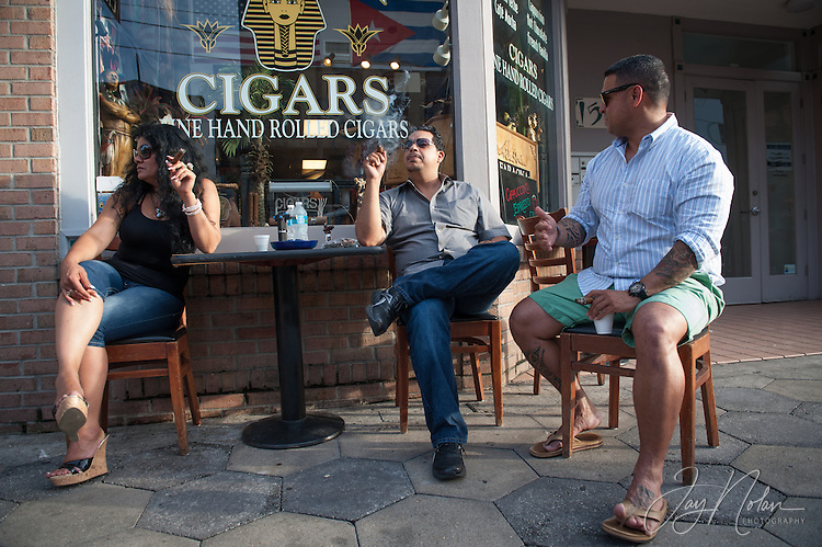 "(l-r) ""La Faraona"", German Rivera and Jose Castro enjoy cigars on 7th Avenue in Ybor City today, Thursday 6/11/15. Photo/Jay Nolan"