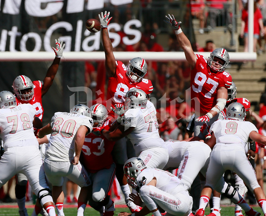 Ohio State Buckeyes defensive linemen Tyquan Lewis (59),  Dre'Mont Jones (86) and Nick Bosa (97) attempt to block a field goal attempt by UNLV Rebels place kicker Evan Pantels (30) during the first quarter of Saturday's NCAA Division I football game at Ohio Stadium in Columbus on September 23, 2017. [Barbara J. Perenic/Dispatch]