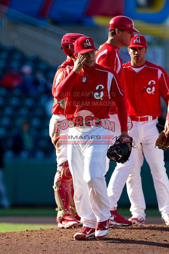 Richard Castillo (27) of the Springfield Cardinals is taken out of a game against the Frisco RoughRiders on April 16, 2011 at Hammons Field in Springfield, Missouri.  Photo By David Welker/Four Seam Images