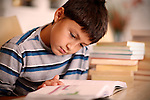 Young boy reading book - EXCLUSIVELY AVAILABLE HERE