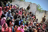 Mogadishu/Somalia 2012 -  Woman waiting at a rally where the Mayor and the president will attend. Security is always intense when the two are showing up at rallies. Al-Shabaab has put a price tag on the Mayors head and will pay 500.000 USD. to anyone who would kill him.