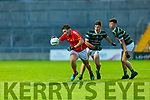 East Kerry's Aaron O'Shea gets through the challenges of Tadgh Reen and Cian Kearney St Brendans in the County Minor football final in Austin Stack Park on Wednesday evening