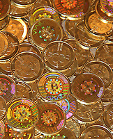 Images of physical bitcoins are seen in this undated handout photo.  The digital alternative currency has recently fallen in value after speculators drove up the price to $200 per bitcoin. The MtGox trading exchange halted trading on the currency April 11, 2013 because a lag in processing caused a panic among investors.