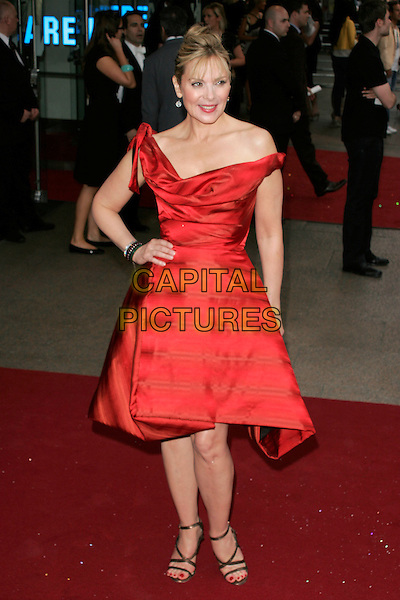 "KIM CATTRALL.Arrivals at the ""Sex And The City: The Movie"" World Premiere, Odeon Leicester Square, London, England, UK. .May 12th 2008 .SATC full length off the shoulder red Vivienne Westwood dress cowel neck black strappy shoes sandals hand on hip.CAP/AH.©Adam Houghton/Capital Pictures."