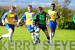 Fenit Samphires Kevin Walsh  gets away from Classic FC's Kenneth Leahy and Kieran O'Regan in the Munster junior cup at Fenit on Sunday.