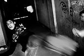 Wroclaw 14.04.2006 Poland<br /> The worst and the most dangerous district in Wroclaw ( Poland ) , called by people &quot;The Bermuda Triangle&quot;. There are walls bearing an inscription &quot;Who will enter here, will not exit alive&quot; Many families there are pathological and live in extreme poverty. Children have no place for any games so they loaf around on this wasted district and disseminate a juvenile delinquency. Many of them become sexually active though thery are only 10-12 years old<br /> (Photo by Adam Lach / Napo Images)<br /> <br /> Najbardziej nabezpieczna dzielnica we Wroclawiu zwana przez ludzi Trojkatem Bermudzkim. Sa tam sciany opatrzone napisem &quot; Kto tu wejdzie, nigdy nie wyjdzie stad zywy&quot; Mieszka tam wiele rodzin patologicznych i zyja w wielkiej nedzy. Dzieci wlocza sie po ulicach nie majac miejsc na zabawe i szerza przestepczosc wsrod nieletnich. Wiele z dzieci uprawia seks choc maja zaledwie 10-12 lat<br /> (Fot Adam Lach / Napo Images)