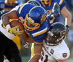 BROOKINGS, SD - NOVEMBER 5:  Isaac Wallace #19 from South Dakota State dives over Dylan Cole #31 form Missouri State in the first half Saturday afternoon at Dana J. Dykhouse Stadium in Brookings. (Photo by Dave Eggen/Inertia)