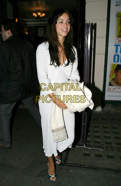 TINA BARRETT.New Ambassador's Theatre - 'The Shape Of Things Press Night.full length, full-elngth, white dress, carrying coat.www.capitalpictures.com.sales@capitalpictures.com.© Capital Pictures.