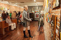 Olivia Jackson takes in the artwork at Arts for ACT Gallery during Art Walk in Downtown Fort Myers River District, Fort Myers, Florida, USA, March 1, 2013. Photo by Debi Pittman Wilkey