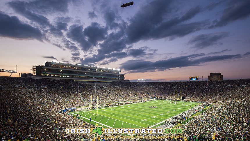 The sun sets over ND Stadium.