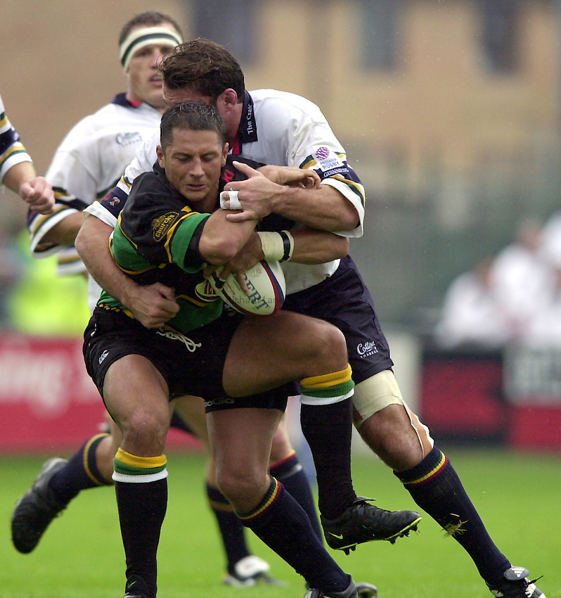 Photo. Richard Lane. .Northampton v London Irish. Zurich Premiership. 26/8/2000..Luca Martin is caught by Kieron Dawson.